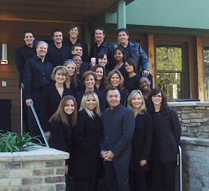 The models/tour guides pose with show home manager Tim Ball, Everett | Reed Meetings + Events, LLC on the steps of the New American Home 2007